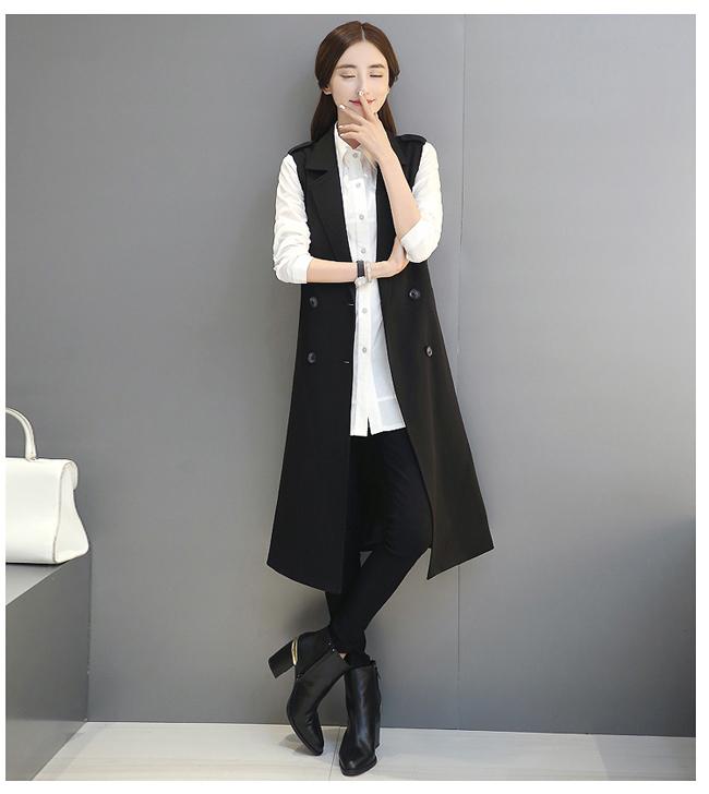 Gile dáng dài đen với đai áo lạ kết hợp với sơ mi trắng và jean trắng.3