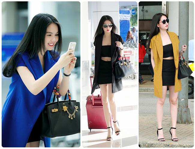 Xuất hiện trên đường phố Hà Nội, Ngọc Trinh đã diện một chiếc áo gilê dáng dài màu đen cùng áo lửng cúp ngực màu trắng và quần short màu đen vô cùng sexy