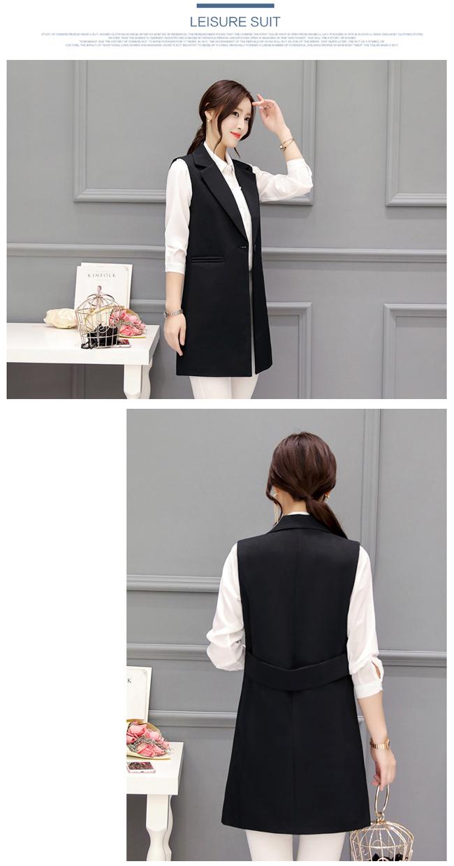 Gile dáng dài đen với đai áo lạ kết hợp với sơ mi trắng và jean trắng.