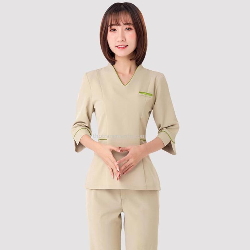 Đồng phục cho nhân viên massage màu kem tay lỡ