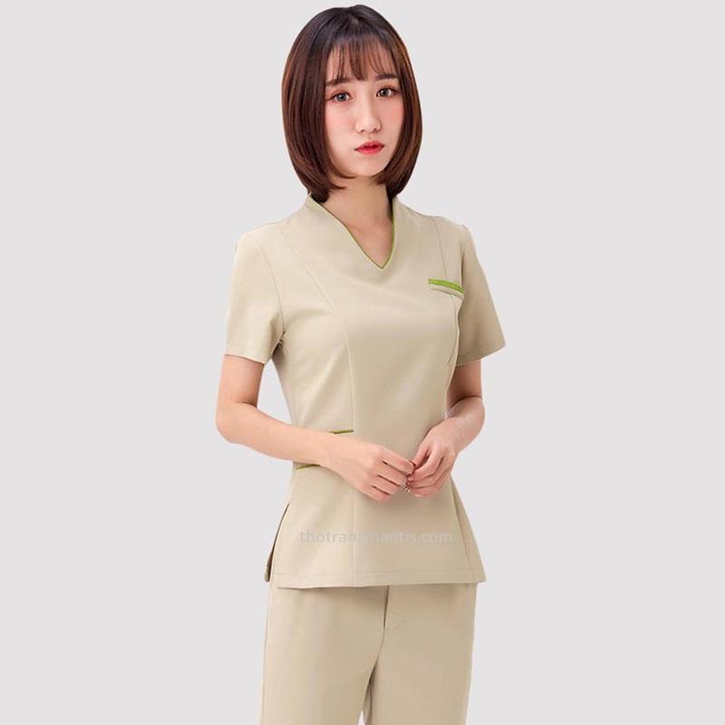 Đồng phục cho nhân viên massage màu kem tay ngắn
